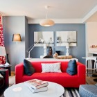 Ikea penthouse - living room with red, white and 3 shades of gray as a color scheme - Craig Paulson via Atticmag