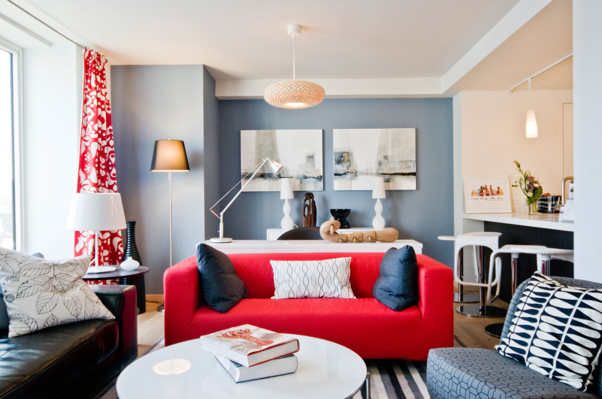 Ikea penthouse - living room with red, white and 3 shades of gray as a color scheme - Paulson via Atticmag