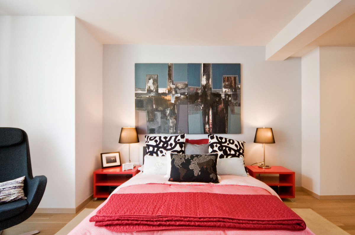 Ikea penthouse - master bedroom with Ikea print fabric accents and a dyptych painting - Craig Paulson via Atticmag