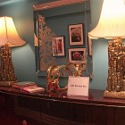 inspired design showhouse - foyer table with a pair of gold Brutalist lamps - Atticmag