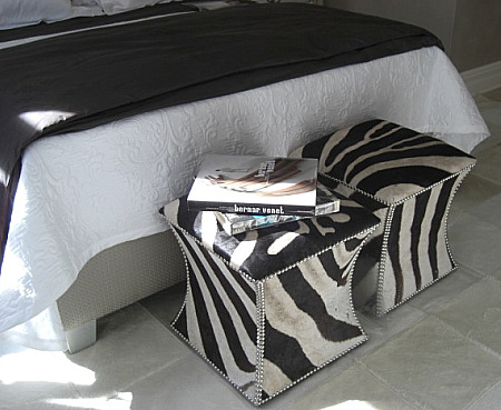 inspired design showhouse - Patrik Lonn bedroom with pair of faux zebra stools at the foot of the bed - Atticmag
