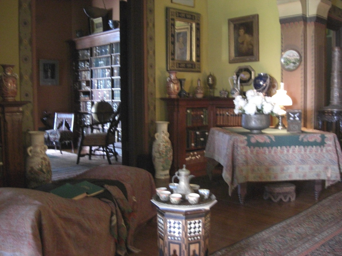 Olana - draped furniture in the mansion's main room painted with color selected by Frederic Church - Atticmag