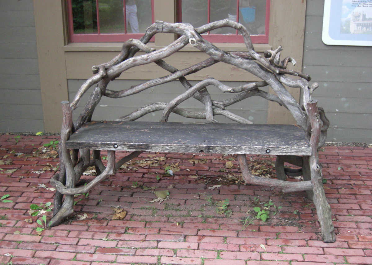 Olana - an exquisite bent twig Victorian garden bench on a brick patio - Atticmag