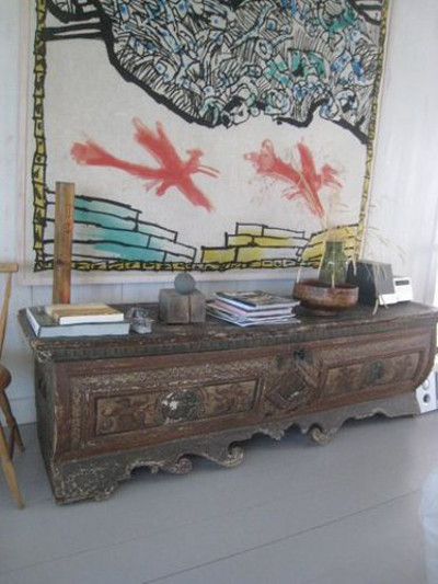 scandinavian summer house - antique Asian chest below a contemporary painting - Atticmag