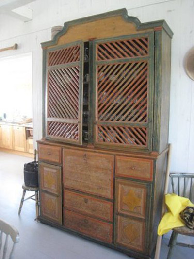 scandinavian summer house - paint decorated antique cabinet in the breakfast room - Atticmag