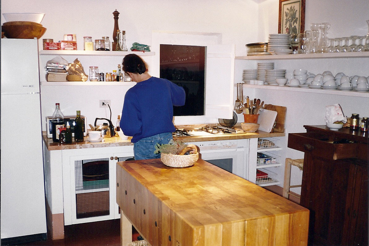 Tuscan villa - kitchen with simple cabinets and appliances - Atticmag