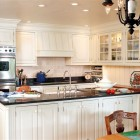 heartland kitchen - Island in Ohio family kitchen with Plain and Fancy Arctic white cabinets and black galaxy granite counters - kitplace.com via Atticmag