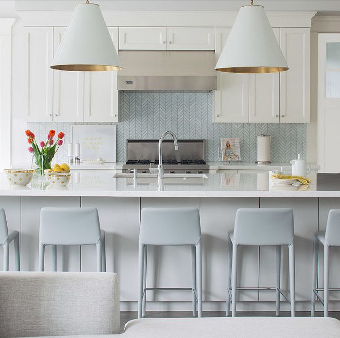 nordic color kitchens - white and pale blue-gray mixed in a kitchen with Goodman pendants from Circa lighting - terris lightfoot via Atticmag