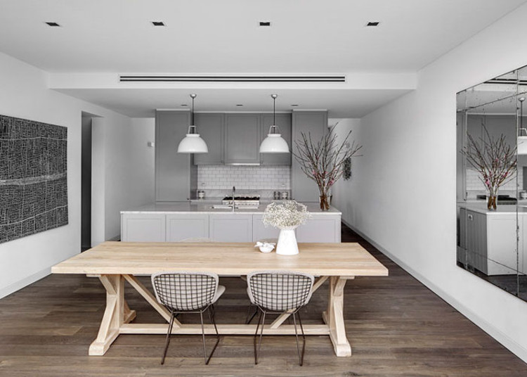 nordic color kitchens - white and gray tones blend with Carrara marble and a light natural wood tables and greyish wood floor - Est Magazine via Atticmag