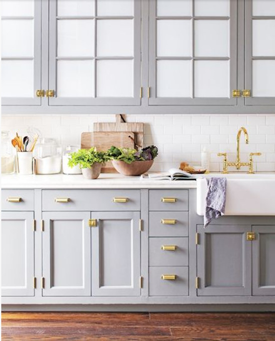 nordic color kitchens - gray and white kitchen with brass hardware and faucets - Martha Stewart via Atticmag