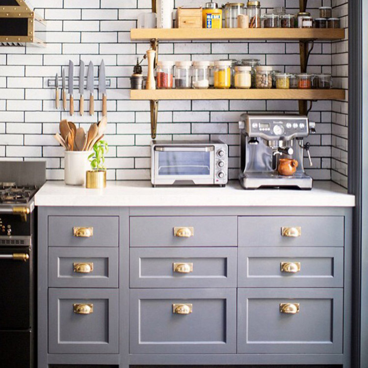 subway tile eurosplash - gray kitchen with white subway tile and black ground used counter to ceiling behind open shelves - domino via atticmag