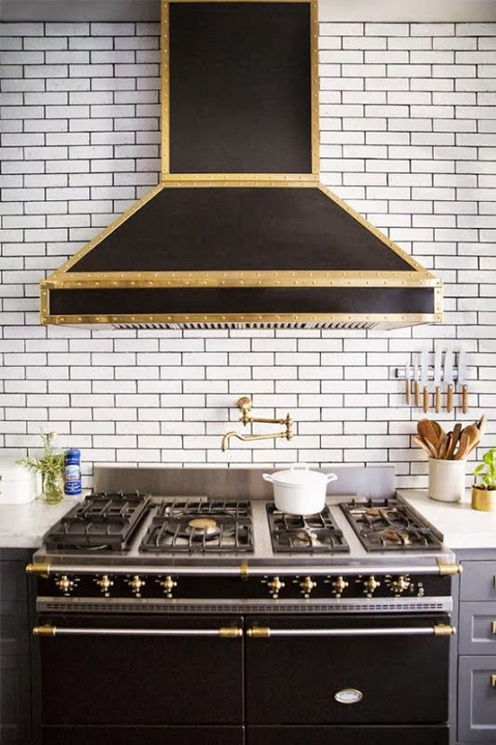 subway tile eurosplash - gray kitchen with white subway tiles and black grout used counter to ceiling behind the black Lacanche range - domino via atticmag