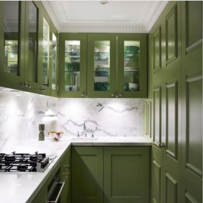 bottle green kitchens - bottle green cabinets in a galley kitchen with white marble - Greg Natale via Atticmag