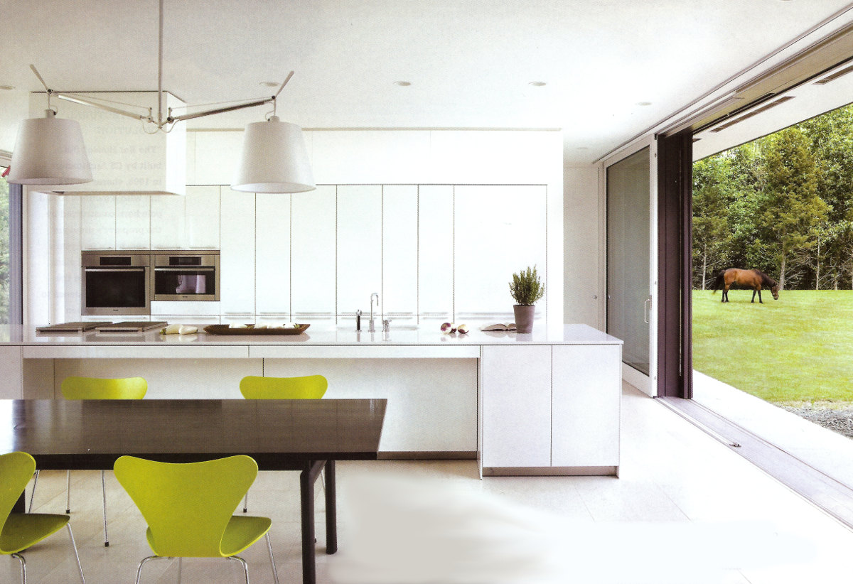 glass wall kitchen - white Bulthaup kitchen with a motorized window wall - NY Spaces via Atticmag