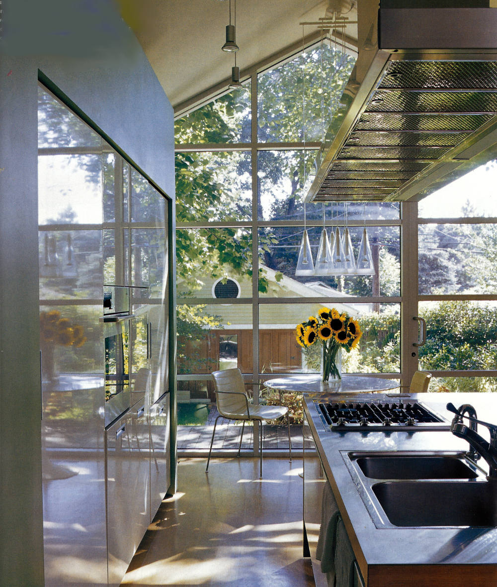 glass wall kitchen - Chicago townhouse kitchen with full glass wall and stainless steel cabinets - Met Home via Atticmag