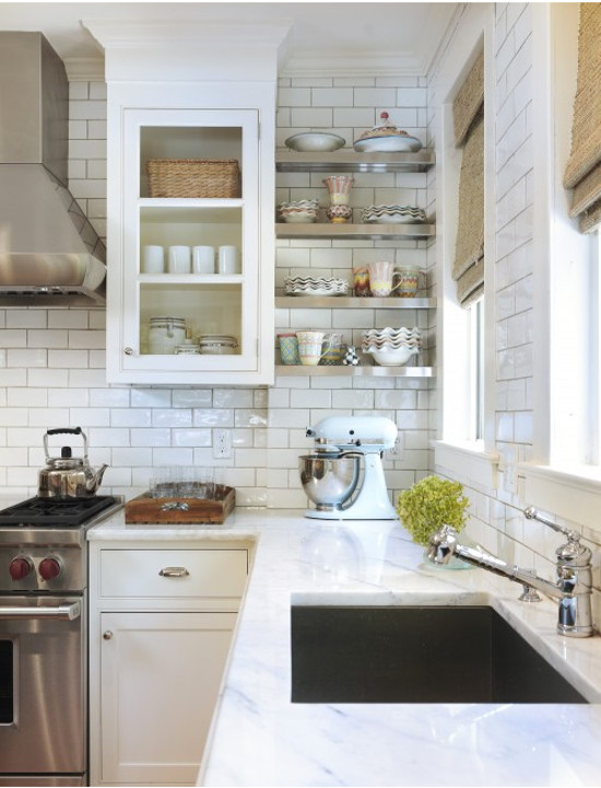 open kitchen shelves - stainless corner shelves installed between a window wall and cabinet - decorpad via atticmag