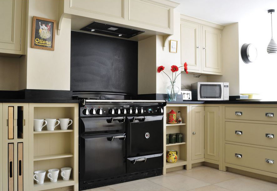 open kitchen shelves - Chichester painted kitchen cabinets with shallow open base cabinet shelves and open pull out cutting board and tray storage - kit stone kitchens via atticmag