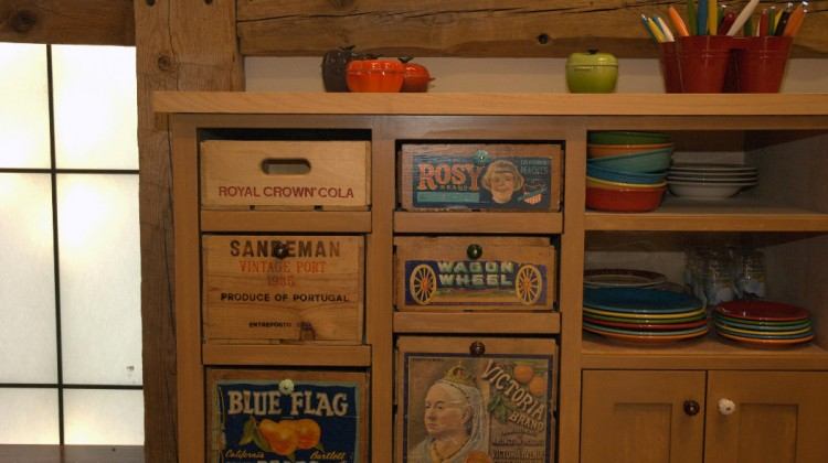 salvage kitchen cabinets - fruit and beverage crate drawer fronts in a California barn kitchen by Studio Carver via Atticmag