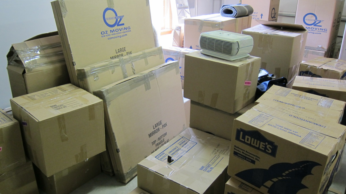 my house - moving boxes stacked in our garage waiting to be unpacked - Atticmag