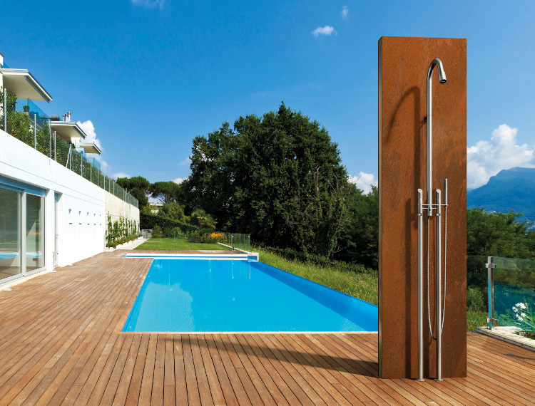 modern outdoor showers - poolside deck shower with MGS stainless steel floor mounted CB406 shower against a wood plinth - MGS via Atticmag