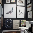 bathroom picture walls - light colored art and fixtures pop against dark painted bathroom walls - nwherald.com via atticmag