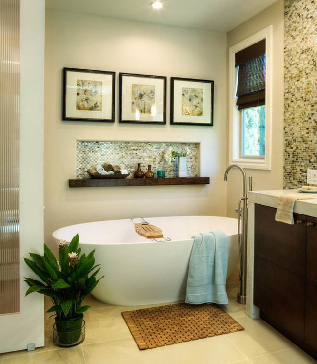 bathroom picture walls - a trio of pictures hung over an above-the-bathtub horizontal niche - hgtv via atticmag