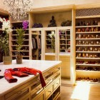 dressing room closet - Gisele Bunchen's cream-colored closet in Boston - AD via Atticmag