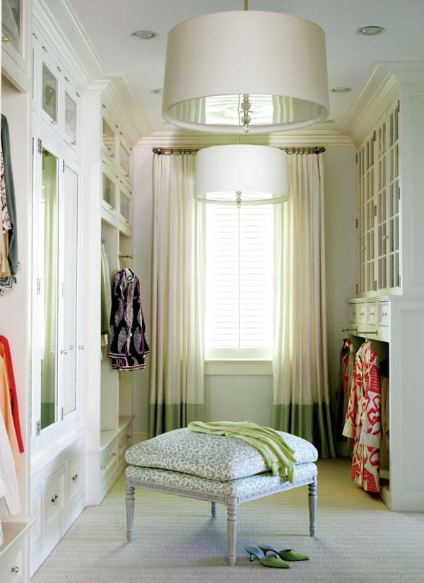 dressing room closet - Designer Louise Brooks closet with double hanging pendant lights, a window and curtains - Trad Home via Atticmag