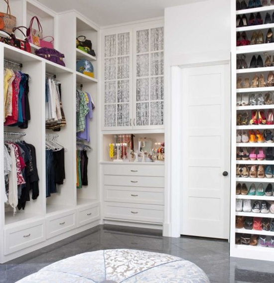 dressing room closet - white-painted closet with handbag shelves and a jewelry counter - Astleford Interiors via Atticmag