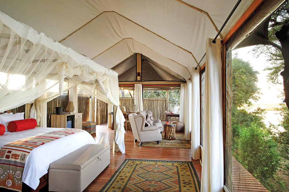 safari camp bedroom - tented Amanzi lodge bedroom on the Zambezi River in Lower Zambezi National Park - anabezi.com via Atticmag