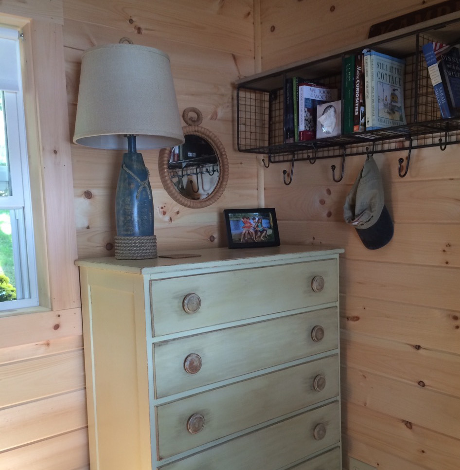 bunkhouse shed - painted antique American chest and vintage lamp in the corner of the lake house shed - Atticmag