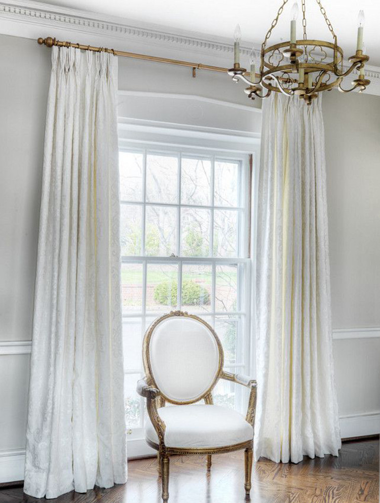 hanging draperies - White draperies hanging on a brass rod over a full length foyer window - Amy Studebaker Design via Atticmag
