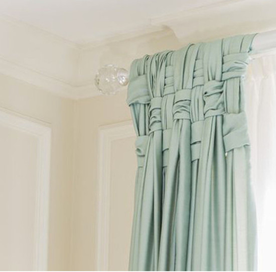 hanging draperies - Detail of woven tops of pale green stationary panels, undercurtains, and moldings - Leslie Fine Interiors via Atticmag