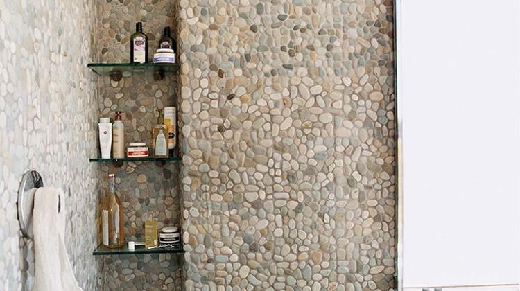 all over natural pebble tile shower and bath - domino via Atticmag.com