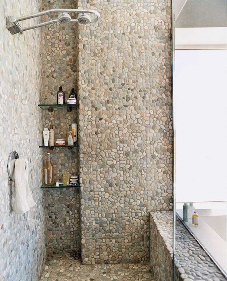 All Over Natural Pebble Tile Shower And Bath Domino Via Atticmag