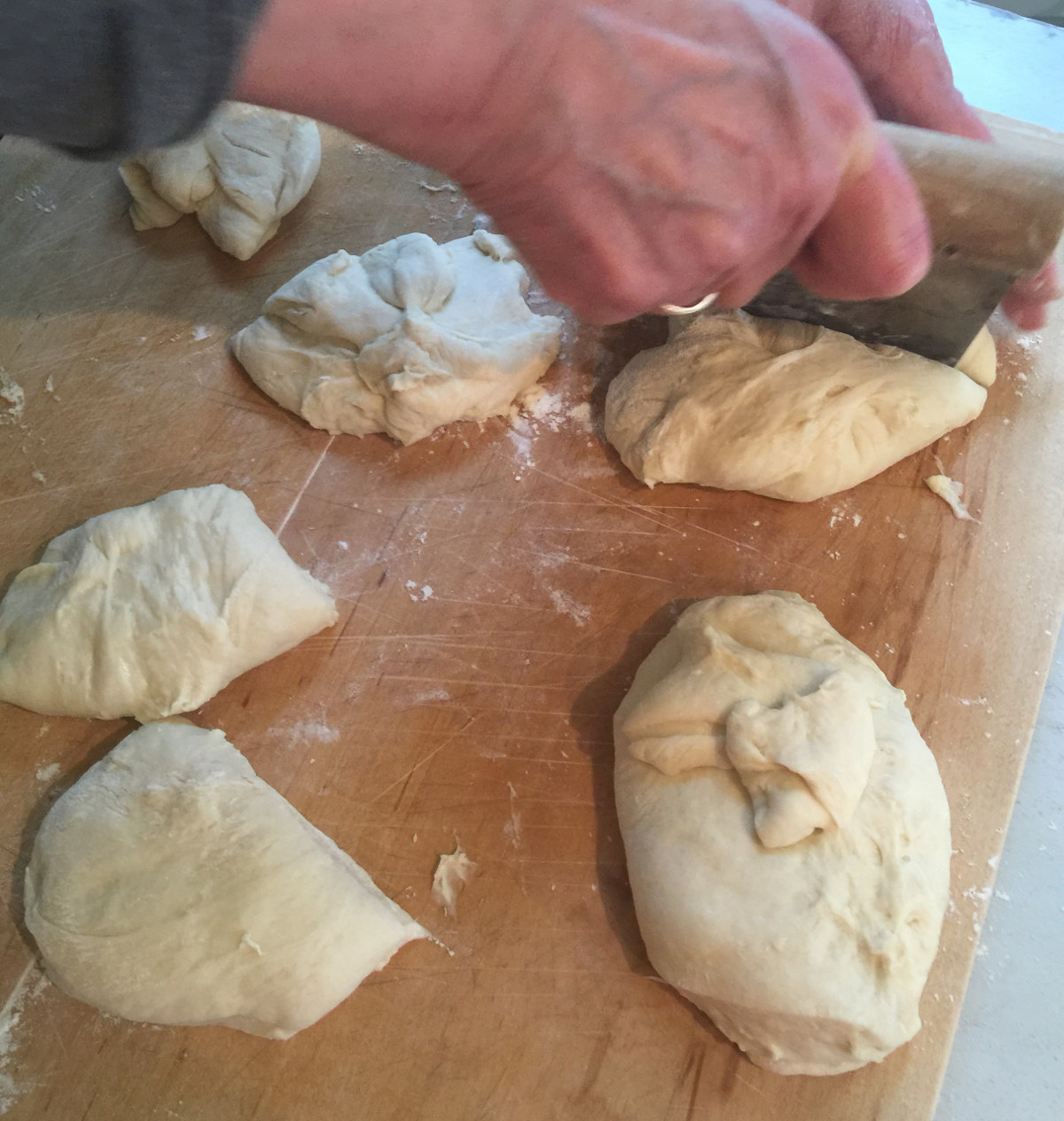 buttermilk cloverleaf rolls - cutting the risen dough into 16 pieces for rolls - Atticmag.com