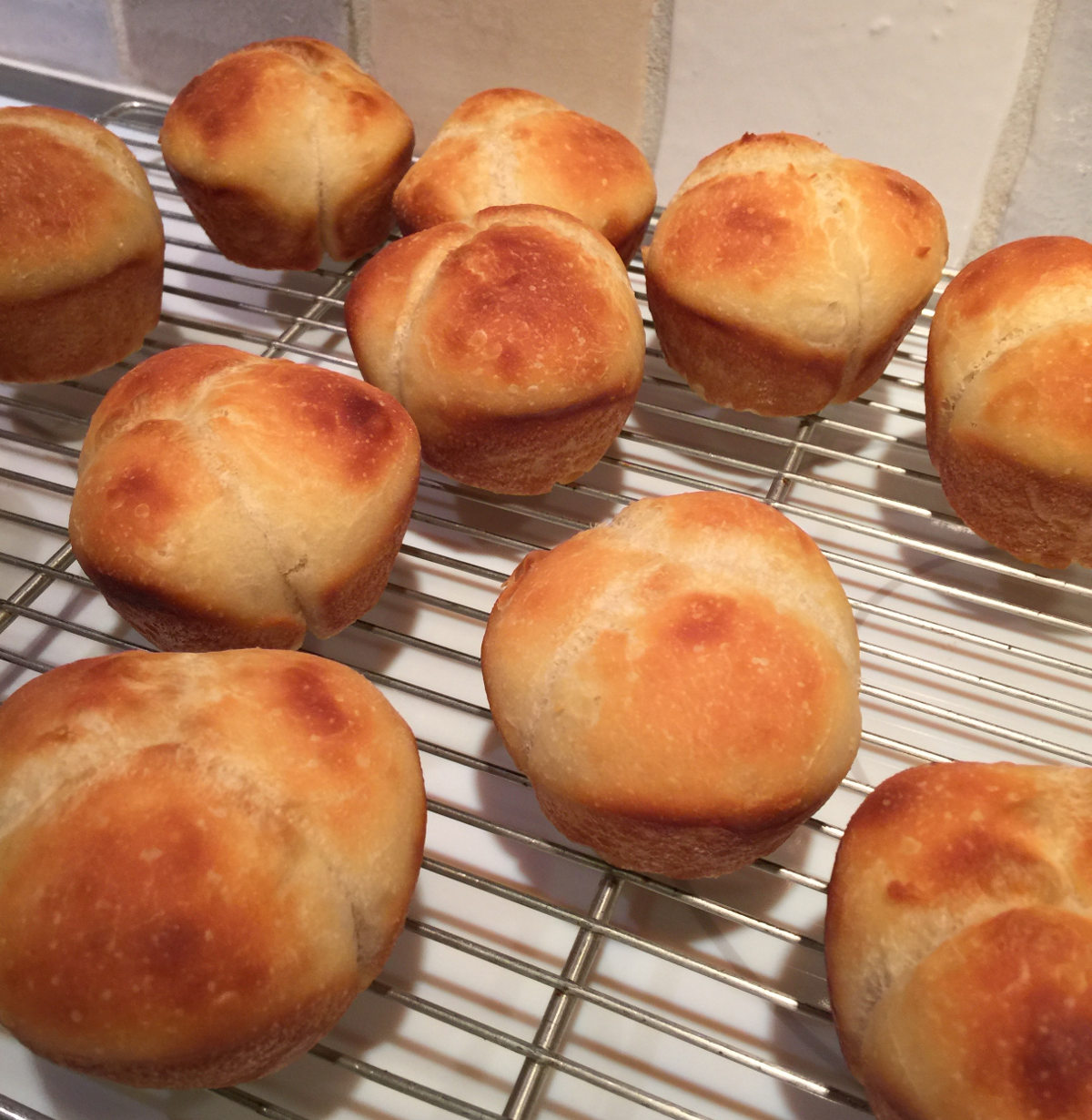 buttermilk cloverleaf rolls - baked rolls cooling on a rack - Atticmag.com