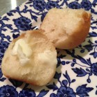 buttermilk cloverleaf rolls - two sections of a warm baked cloverleaf roll after the cook already ate one - Atticmag.com