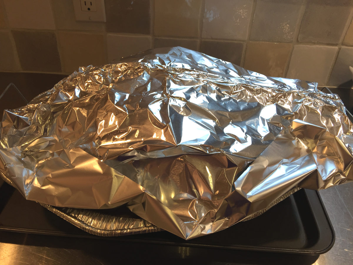 stuffed turkey - an aluminum foil tent over the turkey to control the browning during roasting - Atticmag.com