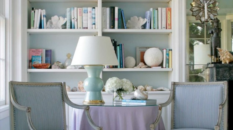 lavender - pale blue sitting room with Swedish armchairs and a lavender skirted table - design house of the hamptons via atticmag.com