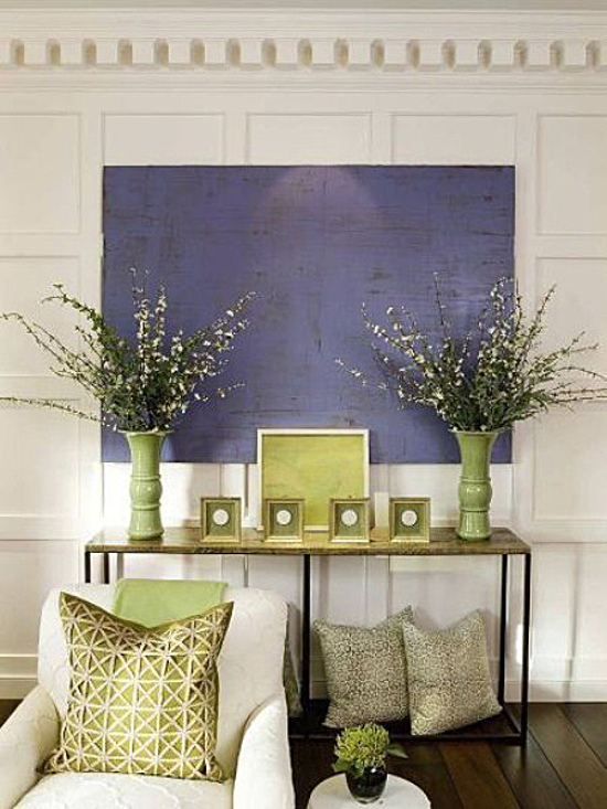 lavender - blue violet painting set off by yellow-green accessories in a cream color room - decorpad via atticmag.com