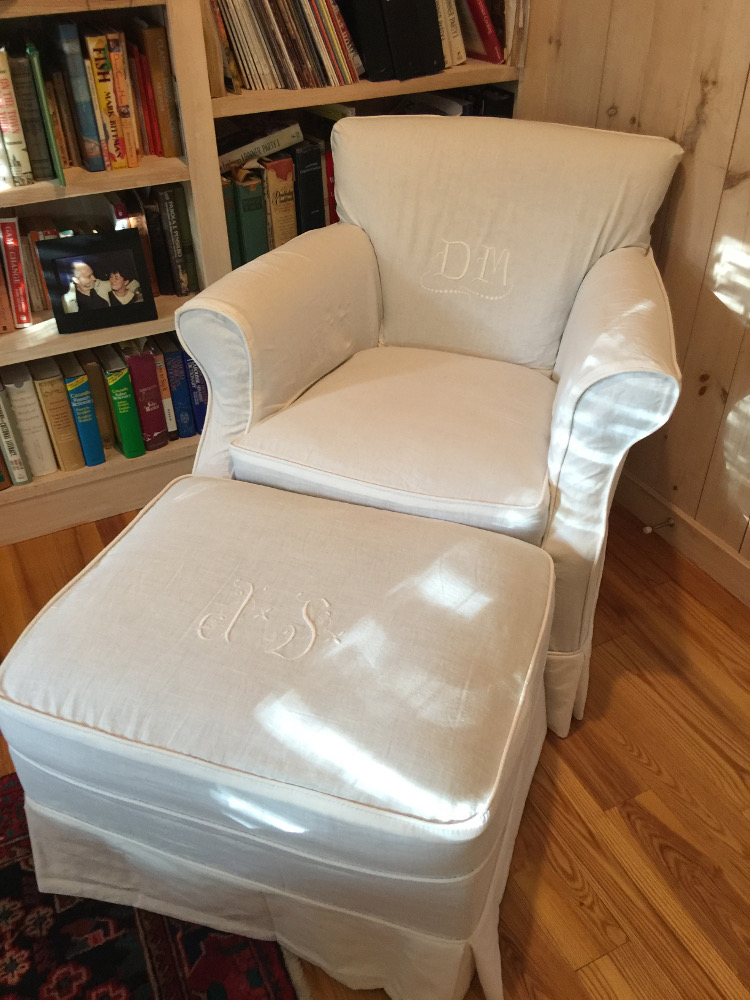 monogrammed slipcover made from embroidered French métis bed sheets for a Crate & Barrel Elyse chair and ottoman - Atticmag