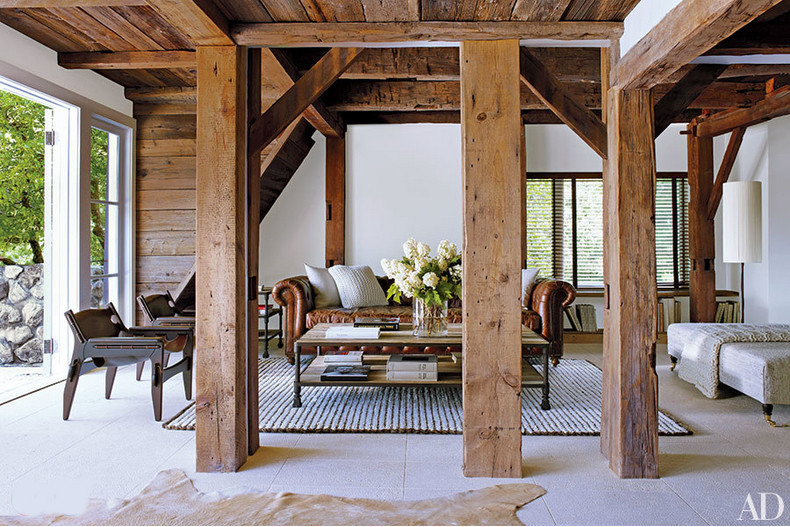 barn living rooms - Renovated Hudson Valley barn living room with Restoration hardware Kensington tufted leather sofa and an oversized ottoman on casters - AD via Atticmag