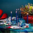Royal Copenhagen Modern Christmas - Fabric designer Cathrine Raben Davidsen vivid red and blue table - Royal Copenhagen via Atticmag