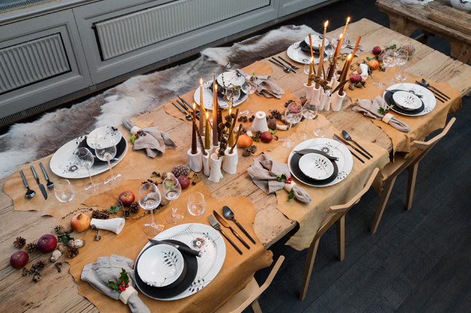 modern Christmas - Chef Tomas Rode and Thilde Maarbjerg's rustic Viking table with fur throws and hide plate mats - Royal Copenhagen via Atticmag