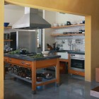 industrial kitchen - warehouse aesthetic unfitted kitchen with open shelving and industrial details - Place Architects via Atticmag.com