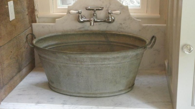 custom laundry room - washtub basin sink with a marble counter and backsplash - salisbury artisans via atticmag