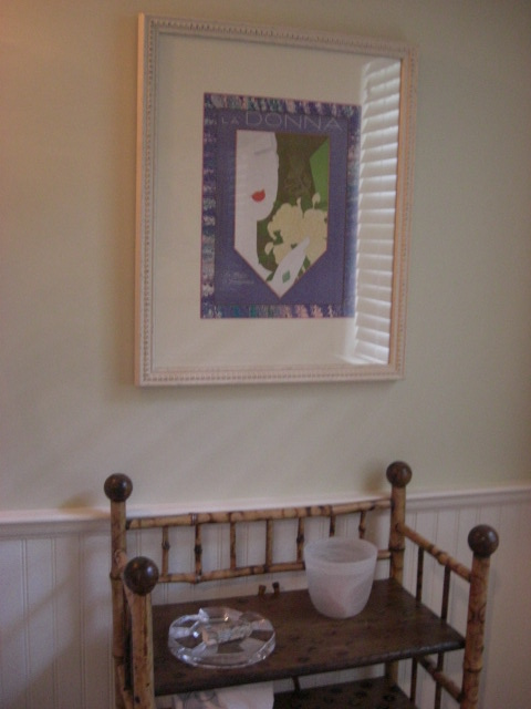 powder room - cover of La Donna, Italian women's magazine from the 1920s on Farrow & Ball Green Ground walls - Atticmag