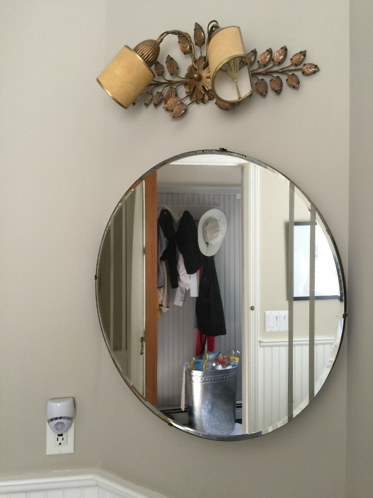 powder room - 1947 Art Deco round mirror in Jane's powder room repainted with Farrow & Ball Stony Ground - Atticmag