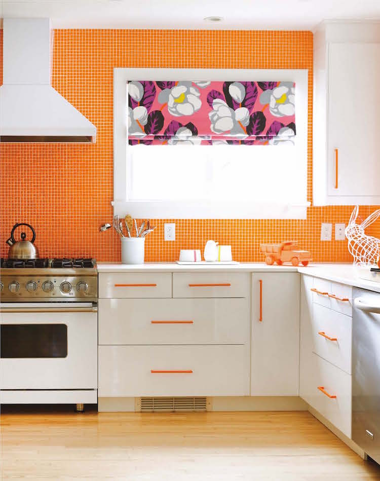 Orange and white kitchen from Apartment Therapy Complete + Happy Home decor book by Maxwell Ryan and Janel Laban; photos by Melanie Acevedo - Potter Style via Atticmag